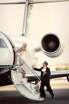 Airplane bride and groom   Photography: Boutwell Studios