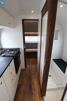 Totally diggin' the dark wood floor w/ white+black interior (1974 Airstream Overlander 26' designed by HofArc)