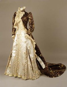 Tea Gown  Charles Fredrick Worth, 1890-1895  The Royal Ontario Museum  -I love the over jacket, the cut of it and the lace