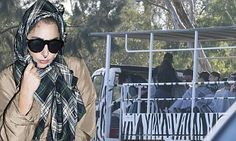 Lady Gaga is granny-chic with plaid scarf and raincoat in Australia #DailyMail