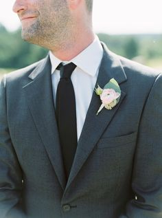 Charcoal gray suit, black tie, ranunculus, pink boutonniere, groom style // Kate Ignatowski Photography