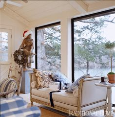 Christmas decorations can be as simple and fun as placing a Santa hat on a statue. - Traditional Home ® / Photo: Jenifer Jordan / Design: Charles Faudree