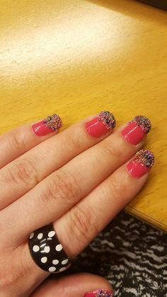 Candy nails. Pink nails with sprinkled color beads. Nail decorations.