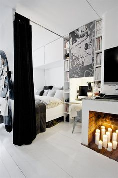 This is from a Scandi Studio flat on onekindesign.com. They have just placed  wall and curtain around the double bed which looks great despite being so compact.