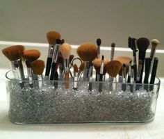 Easy makeup brush holder. Just fill up a clear container with small marbles or rocks. It is so easy! More organizing tips to come from Fresh Tech Maid!