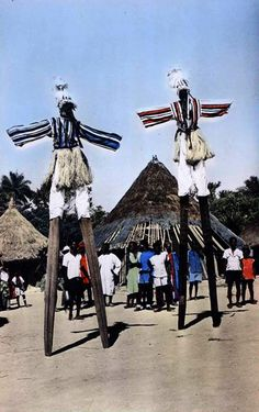 Africa | Stilt masked dancers.  Man Village, Ivory Coast || Vintage postcard; published by HOA QUI