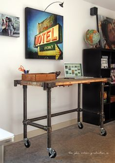 Cart, meet world. World, meet cart. New work cart for studio. Top and pipe reclaimed, purchased Kee Klamps and wheels. Still need to add bottom shelf, adjustable computer stand and margarita. © john urban
