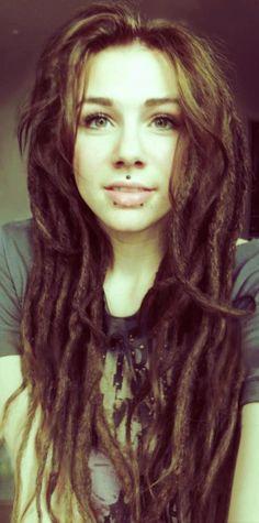Wow, she looks like Miley Cyrus with piercings and dreadlocks.