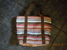 "Nylon Insullated tote bag measures aprox. 11"" x 14"" x 4""   $20"