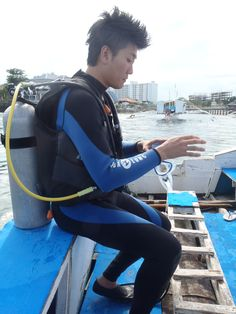 With scuba equipments
