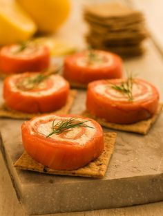 Smoked Salmon Hors d'Oeuvres. Made with smoke salmon, cream cheese, mustard, green onions nestled on top of whole wheat crackers. Great appetizer!
