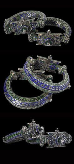 Pakistan ~ Punjab | Pair of Champieve enamel silver anklets (Jhanhjar) | 19th century | Possibly such anklets were worn at weddings. They are of hollow sheet silver and have been chased and repoussed and then decorated with green and dark blue enamel.