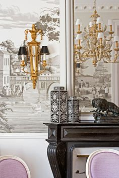 Add Art and Accessories. Hôtel du Lac. de Gournay wallpaper and gilded sconces.