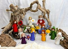 Waldorf inspired needle felted flower-dolls: Mother Earth and Her Children / The Story of The Root Children (by Sibylle Von Olfers). $395.00, via Etsy.