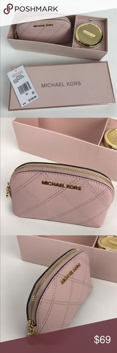 """Michael Kors Blossom Cosmetic Case & Mirror Condition: New in box with Compact Mirror  A luxe Saffiano Leather charm-adorned cosmetics case. Interior lined with 1 zip pocket. Zip closure, gold toned hardware and MK logo. 8"""" W x 5"""" H x 3"""" D. Style 34T6GGFM2L. RB676  Thank you for your interest!  PLEASE - NO TRADES / NO LOW BALL OFFERS / NO OFFERS IN COMMENTS - USE THE OFFER LINK :-) Michael Kors Bags Cosmetic Bags & Cases"""