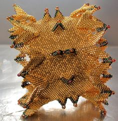 """53.5mm/2.1"""" wide on adjustable brass cuff-ultrasuede lined, this bold piece is woven with 24kt gold Toho cylinders and high metallic iris accents. Moveable wings, fixed horns. Never fails to get everyone's attention and awe!"""
