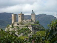 Château de Foix, Ariège, France - sits high above the Ariege River in the French Pyrenees. Built on an older 7th century fortification, the castle is documented from 987. In 1002, it was mentioned in the will of Roger I, Count of Carcassonne, who bequeathed the fortress to his youngest child, Bernard. The castle provided control over the whole of the upper Ariège valley.