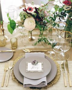 Marbled acrylic placecards with calligraphy and pieces of amethyst add even more interest to this grey and gold table.
