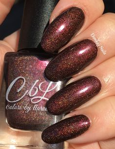 The Polish of the Month for November 2016 is called Turning Leaves.  This polish is a rich copper brown glowing holo with intense red shimmer.  Swatch by @ehmkaynails.