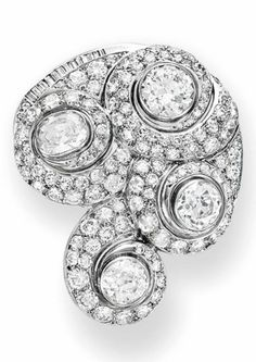 AN ART DECO DIAMOND ESCARGOT BROOCH, BY SUZANNNE BELPERRON, CIRCA 1932-1940. Designed as a series of old European-cut diamond scrolls, centring upon bezel-set old-mine cut diamonds, to the baguette-cut diamond trim, mounted in 18k white gold, with French importation marks and maker's marks of Groené et Darde for Suzanne Belperron. #Belperron #ArtDeco #brooch
