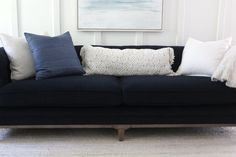A formal frame inspired by the Chesterfield becomes casually comfortable. Simplified tufting and velvety-soft navy plush with an exposed-wood base in antiqued walnut. Professional Cleaning Services, Exposed Wood, Furniture Covers, Tufting Buttons, Chesterfield, Coastal Living, Love Seat, Plush, Sofa