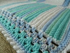 Ravelry: debbieredman's Stripy Squares in blue with granny edging