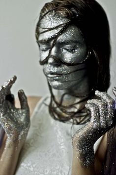 DAMN! Looks like somebody pulled her out of the makeup trough!! What'd she do? Fall in? LOL! Yes, this was done on purpose - (Marina Miguens By Florencia Petra For Catalogue Alto Summer 2013 - glitter makeup)