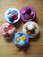 ButtonArtMuseum.com - Dorset Button Medley Brooches by Rosalind Atkins, showcasing 5 traditional designs of Dorset button