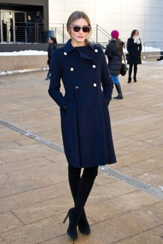 New York Fashion Week: Outside Lincoln Center, the always-chic Olivia layered up with a military-style coat.