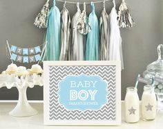 Blue Tassel Garland DIY KITS are a stylish way to decorate your birthday or baby shower! Shimmery silver, light blue, and white hues are perfect for a