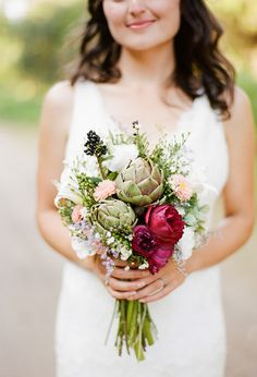 Wild flowers, berries and artichokes bouquet