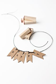 Cute way to update gift wrapping/ alternative way to tag wine glasses? from: KRAFT FLAG GIFT TAGS + MINI GARLAND D.I.Y. | Besotted