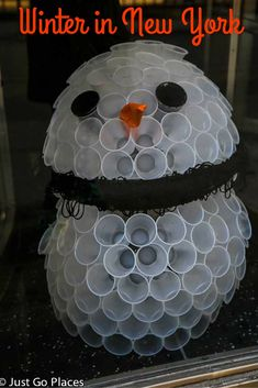A Fairytale of New York - recycled cups creating a snowman