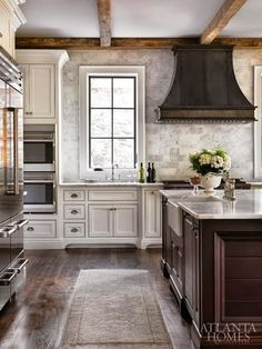 kitchen - sink in island means no splash back required. will help keep things clean looking. L. KAE Interiors.