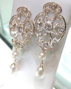 Handmade diamond and pearl earrings in 14k gold by Baxley Jewelers of Carrollton