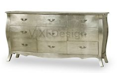 Modern-French-Style-Silver-Leaf-Dresser-antique form and hardware with light reflecting finish...imagine it reflecting the flicker of a dozen candles!