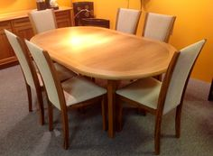 SM 14 Dining Table in Teak. Comes with 2 leaves. Available at Scanhome Furnishings in Green Bay.