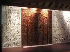 balinese doors on a feature wall