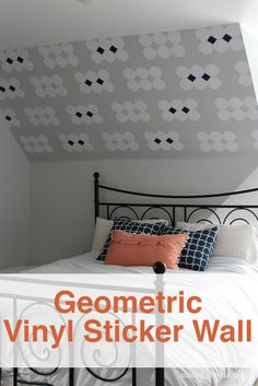 Cut your own vinyl stickers and create a fun geometric wall with your design. Such a fun idea.