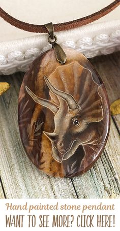 Triceratops dinosaur pendant. Hand painted by oil paints natural stone. Each pendant is unique, I don't make any copy. You can buy it in my shop, I make sales each month. My nickname on Facebook, Instagram and Devianart is same - LunarFerns