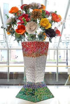 ReBloom is a fourteen foot tall sculpture designed and fabricated by the youth in Artists For Humanity's 3D Design Studio.  Commissioned by Bank of America to promote recycling in their Boston offices, the vase is constructed out of recycled materials including reclaimed office paper, cardboard and soda cans.