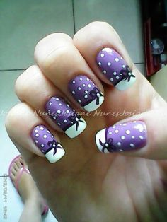 Purple and white polka dot with bows nails