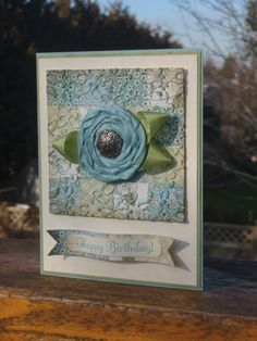 """Like the embossed quilt square.  I think the flower is created on a """"glubber"""" base."""