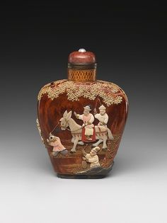 Snuff Bottle. Date: 19th century. Culture: China. Medium: Lacquer on metal, patterned with colored stones.