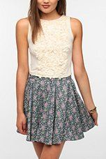 Love the whole thing! From Urban Outfitters...Pins And Needles Rosette Crop Tank Top