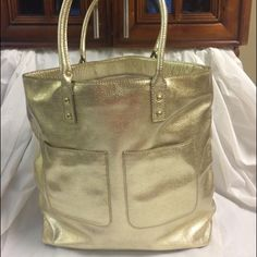 Selling this J crew metallic gold front pocket leather tote in my Poshmark closet! My username is: b287807. #shopmycloset #poshmark #fashion #shopping #style #forsale #J. Crew #Handbags