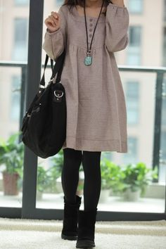 Tunic dress over thick tights and short suede boots.