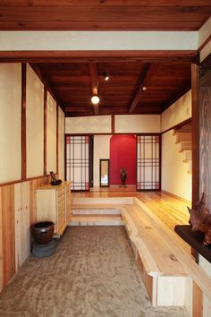 Genkan (玄関) are traditional Japanese entryway areas for a house, apartment, or building—something of a combination of a porch and a doormat. The primary function of genkan is for the removal of shoes before entering the main part of the house or building.