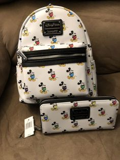 Mickey Mouse Mini Backpack by Loungefly with matching wallet Cute Disney Outfits, Disneyland Outfits, Disney Handbags, Disney Purse, Cute Mini Backpacks, Stylish Backpacks, Mochila Mickey Mouse, Mickey Backpack, Disney Merchandise