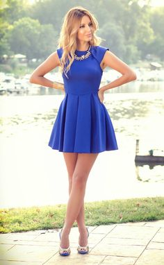 blue dress with gold accessories.
